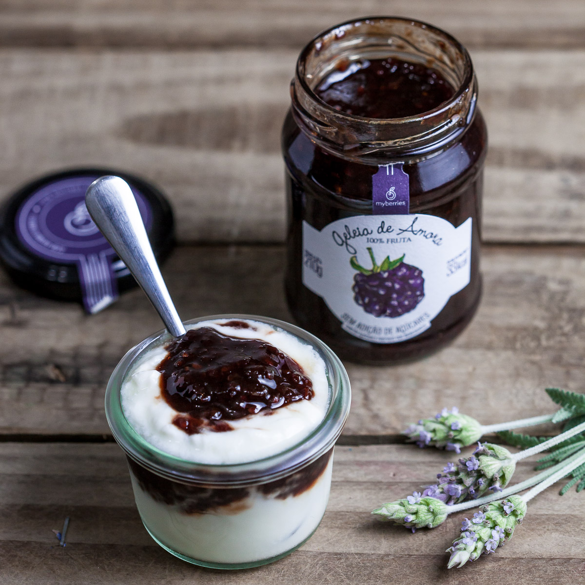 Food photo with yogurt and blueberru jam, decorated with lavander